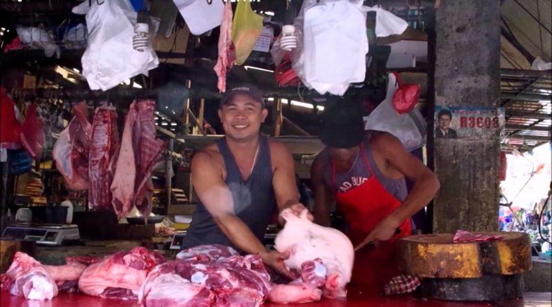 Die Philippinen im Video - Metzger bei der Arbeit auf dem Markt